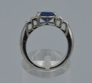 Platinum ring with one center Sapphire and four side diamond Baguettes.