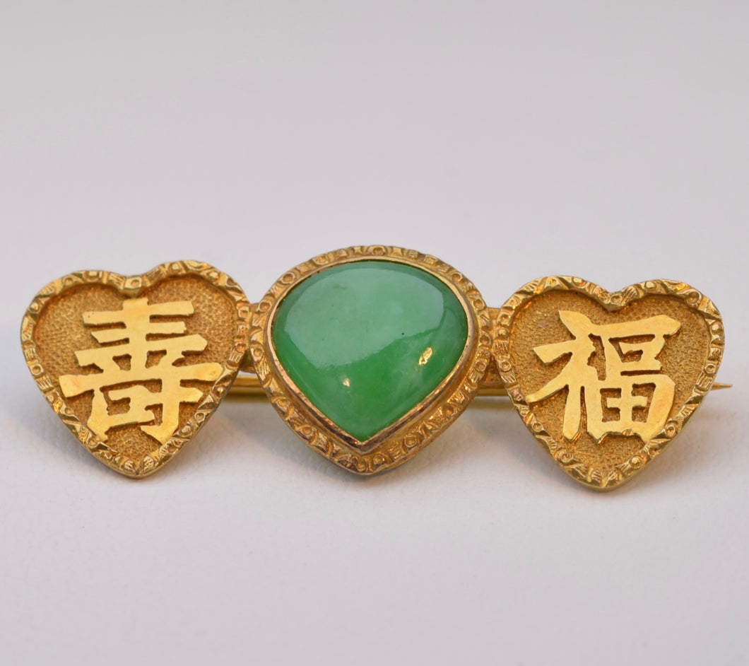 Vivid green Jadeite brooch in 18K yellow gold with Chinese characters