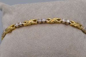 14K yellow gold and diamond bracelet - Hugs & Kisses design