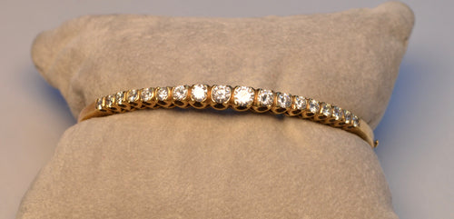14K yellow gold bangle with 17 diamonds