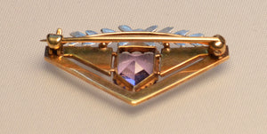 14K yellow gold brooch with white gold floral trim on top and Amethyst, with white enamel trims