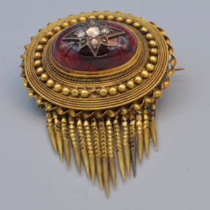 Antique Etruscan Revival brooch with Carbuncle center set with old rose cut diamonds, ca. 1860