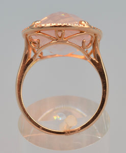 14K rose gold ring with transparent rose quartz framed with diamonds