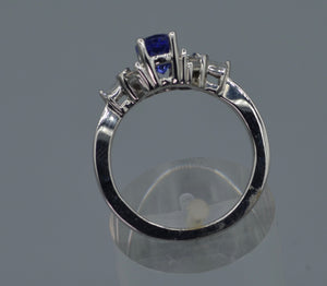 14K white gold ring with one center oval Tanzanite and six side Diamond baguettes