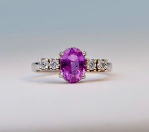 14K white gold ring with one oval Pink Sapphire and 4 Diamonds