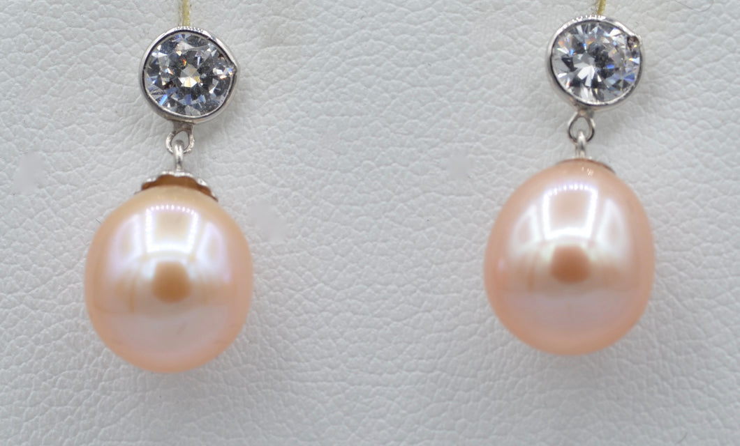 14K white gold earrings with drop shaped pink fresh water pearls and 5mm Cubic Zirconia posts