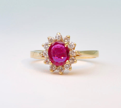 14K yellow gold ring with one center Ruby and 12 surrounding Diamonds