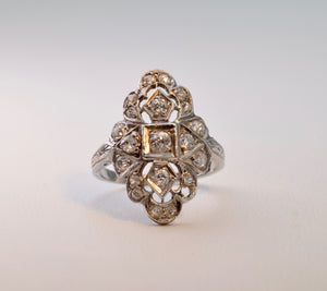 14K white gold Antique ring with 20 old mine cut Diamonds, ca.1920