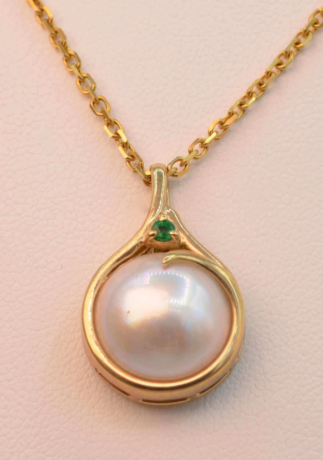 14K yellow gold Moby Pearl pendant with 15mm Moby Pearl and one deep green Emerald trim