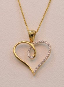 14K yellow gold heart-shaped pendant, half set with diamonds