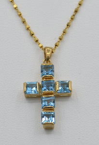 14K yellow gold cross set with square Blue Topaz