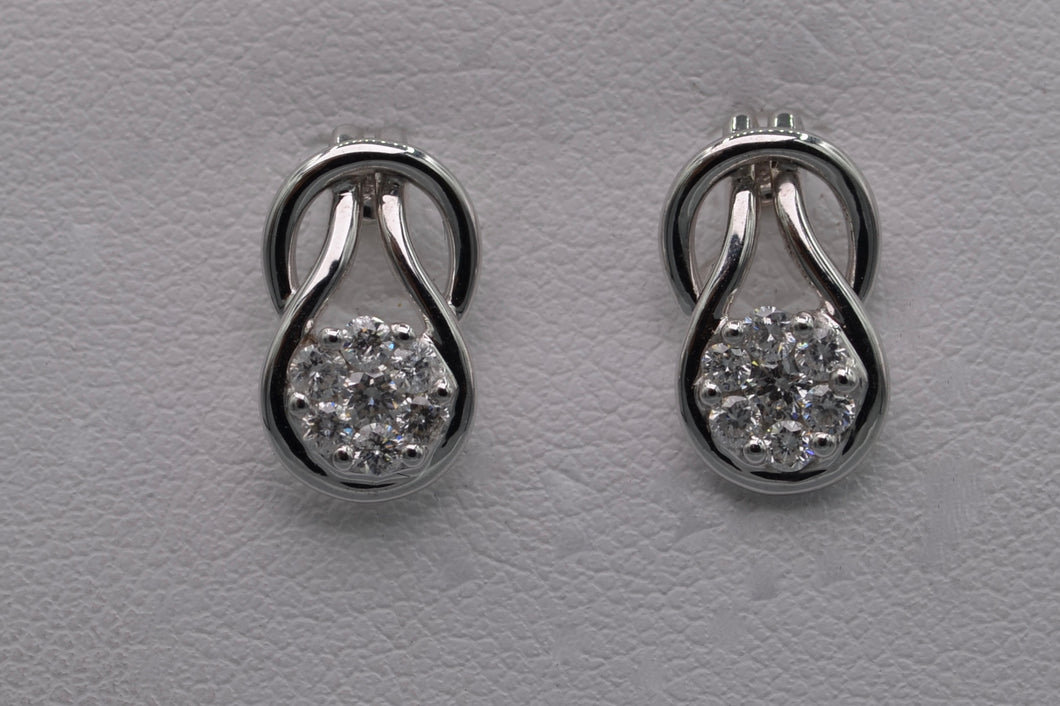 14K white gold post earrings with seven-diamond clusters