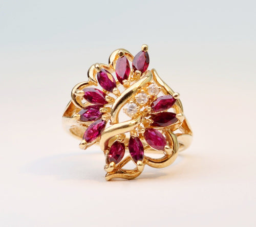 14K yellow gold Ruby/Diamond cocktail ring with  11 Marquise-shaped Rubies and 3 Diamonds