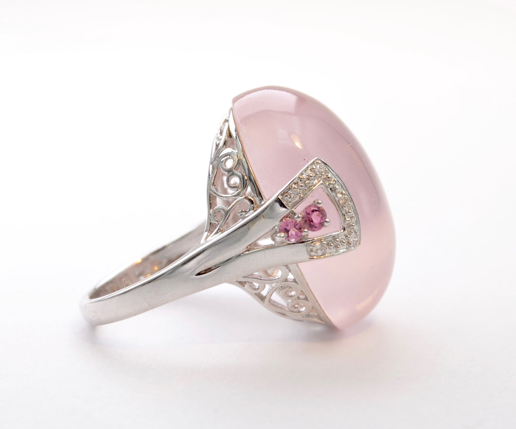 14K white gold ring with one large Rose Quartz cabochon framed with diamonds and pink Sapphires
