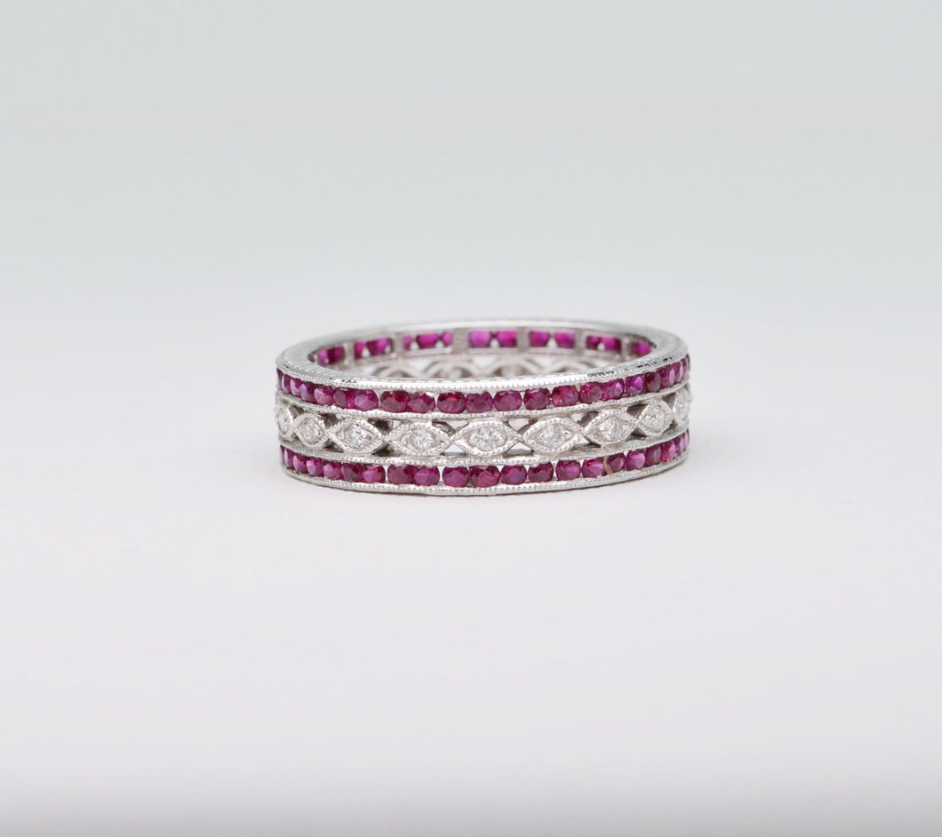 18K white gold wedding band with 2 rows of Rubies framing one center row of diamonds