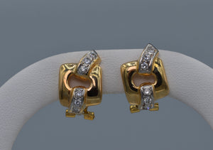 14K yellow gold earrings with diamond trims and omega backs