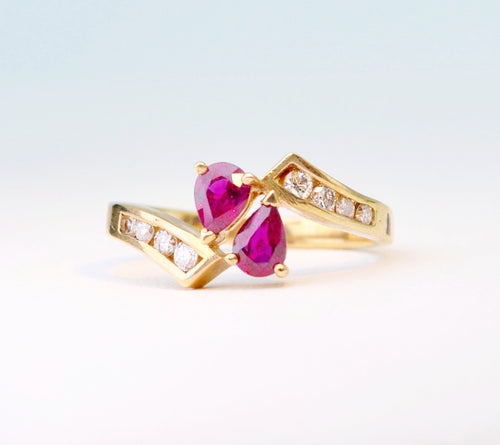 14K yellow gold ring with 2 pear-shaped Rubies and 8 side Diamonds
