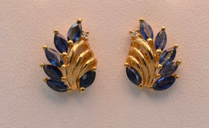 14K yellow gold blue sapphire post earrings with one diamond
