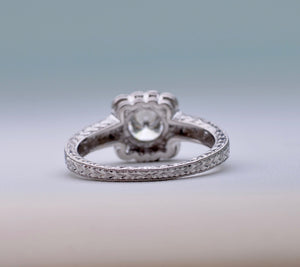 Platinum ring with one center and 15 side Diamonds