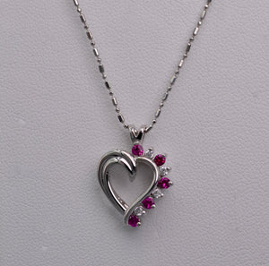 14K white gold heart-shaped pendant with Rubies and Diamonds