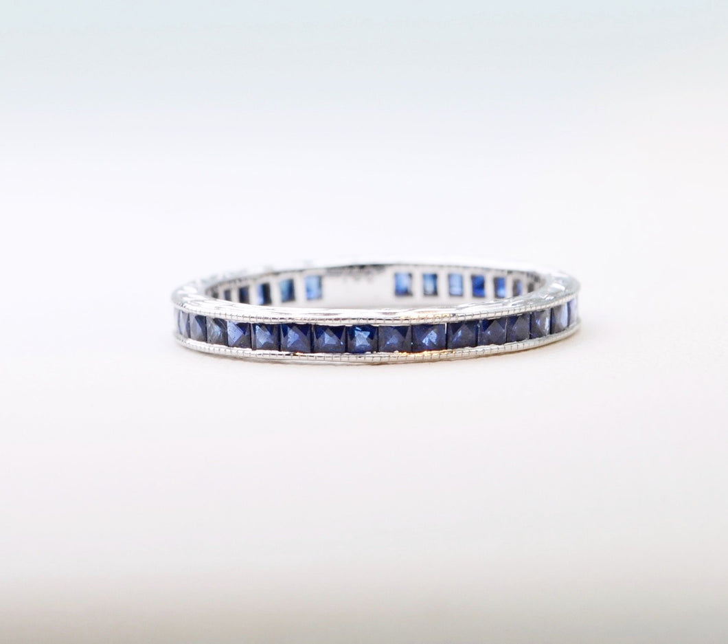 18K white gold Sapphire band with French-cut Blue Sapphires all around