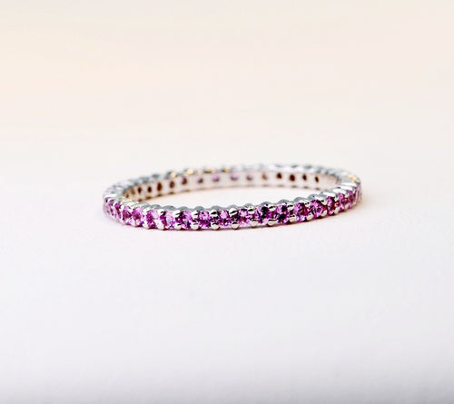 18K white gold band with 1.7mm Pink Sapphires all around