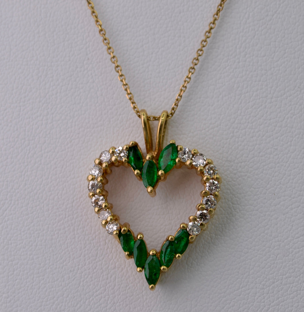 14K yellow gold heart-shaped pendant with Emeralds and Diamonds