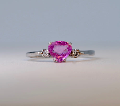 14K White Gold ring with one center Pink Sapphire and 2 side Diamonds