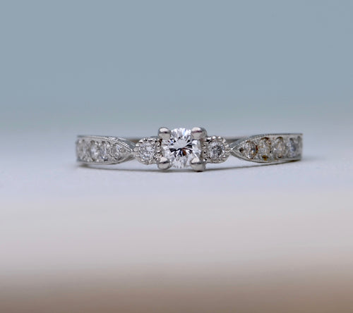 Delicate diamond ring in 14K white gold