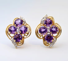14K yellow gold earrings with four round Amethysts in each earring and diamond trims