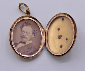 14K yellow gold locket with photo inside decorated with Rubies and seed pearls