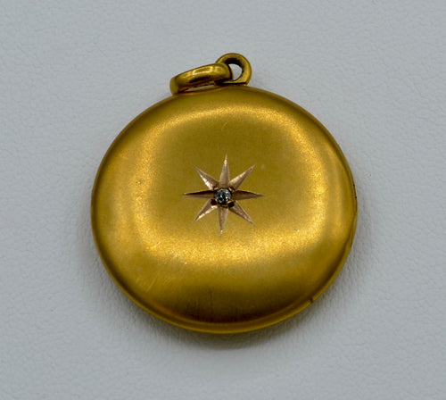 14K yellow gold locket with one diamond star burst on front