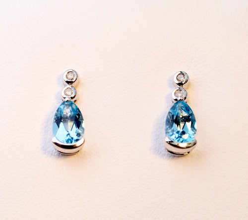 14K white gold post earrings with pear-shaped Blue Topaz drops