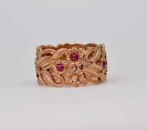 14K Rose gold wide band ring, set with 1mm Ruby cabs