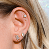 White opal and gold cute ear piercings triple helix piercing double lobe piercing