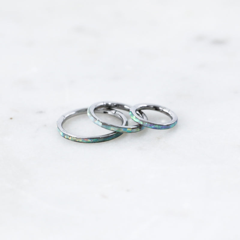 Different sizes of White Inset Opal Hinged Seam Ring