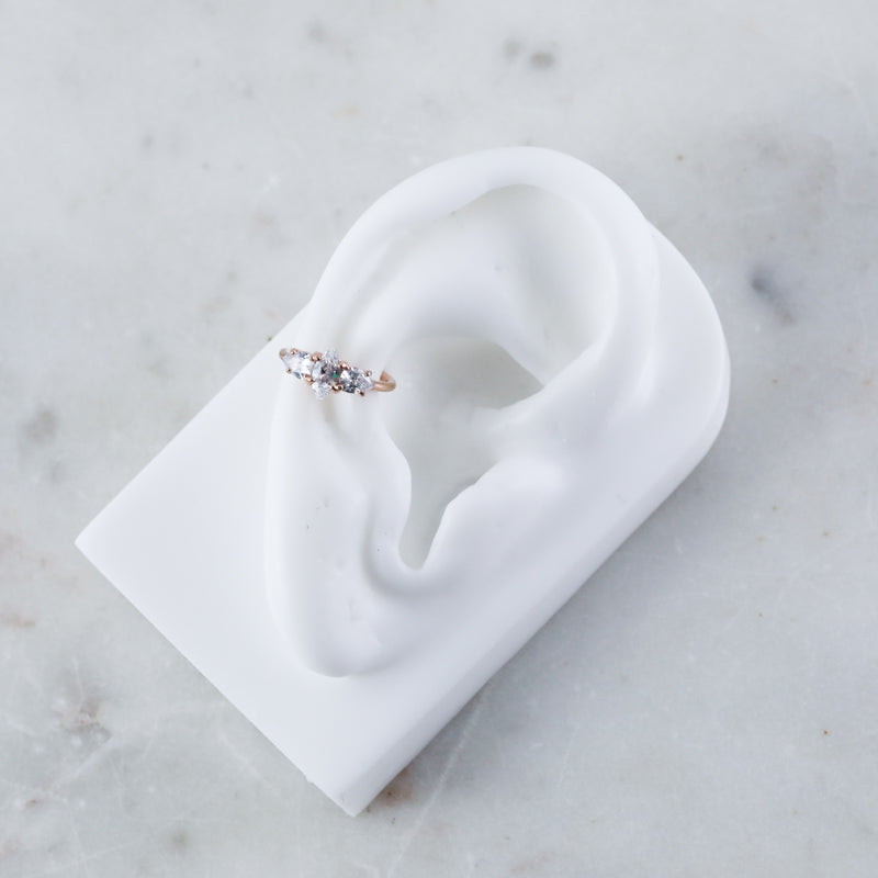 Guinevere Hinged Seam Ring, a Hoop For Conch Piercing in Rose Gold on Model Ear