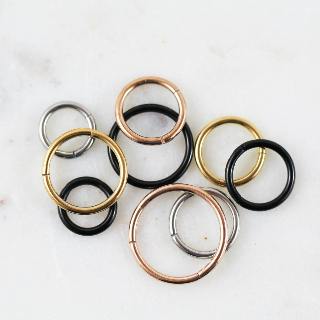 Cartilage Piercing Hoops in Gold, Rose Gold, Black, and Silver. Can also be used as Nose Piercing Hoop.