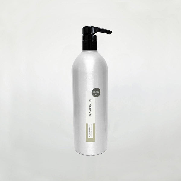 Product image of a 16oz aluminum bottle with a black pump top for zero waste lavender geranium shampoo refills.
