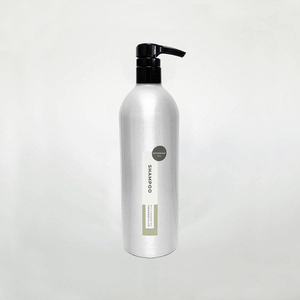 Product image of a 16oz aluminum bottle with a black pump top for zero waste peppermint shampoo refills.