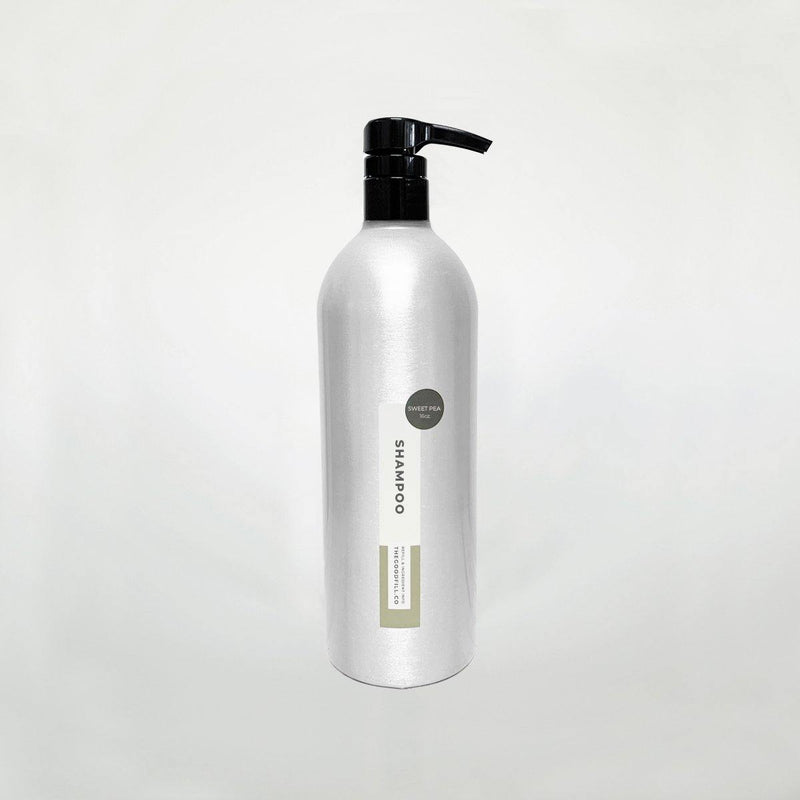 Product image of a 16oz aluminum bottle with a black pump top for zero waste sweet pea shampoo refills.