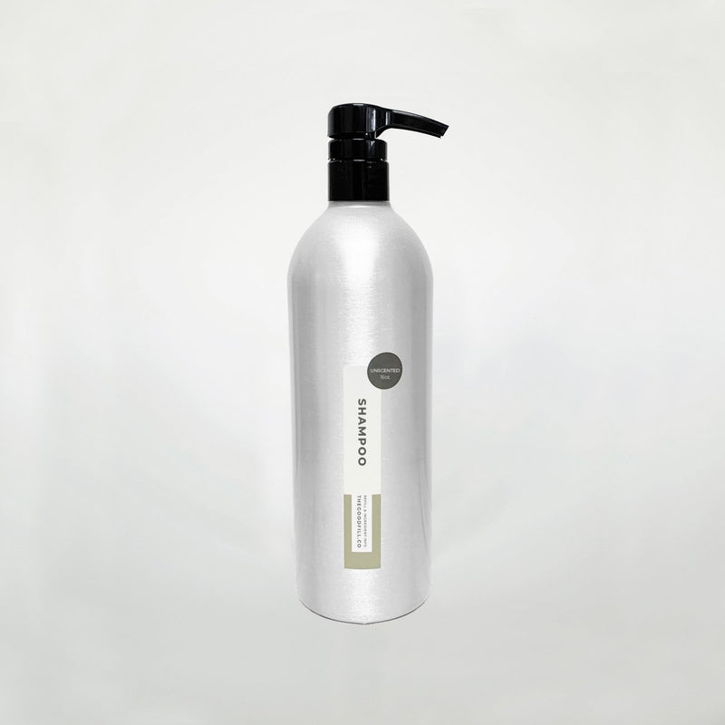 Product image of a 16oz aluminum bottle with a black pump top for zero waste unscented shampoo refills.
