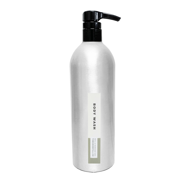 Product image of a 16oz aluminum bottle with a black pump top for zero waste unscented body wash refills.