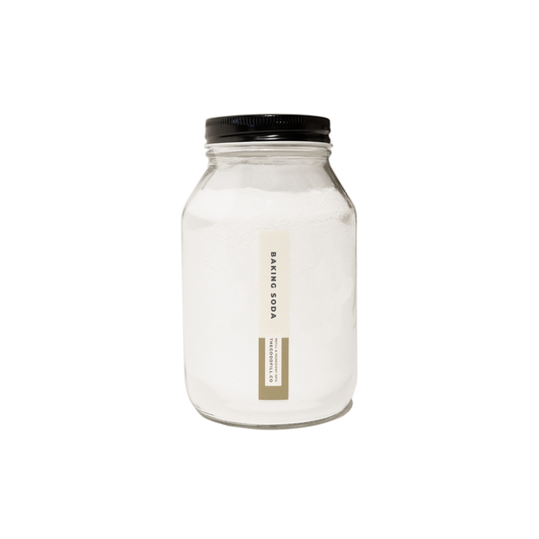 Product image of a clear glass 16oz refill mason jar that is filled with white baking soda and has a black recyclable aluminum screw on lid.