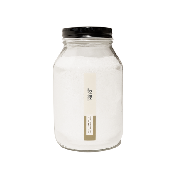 Product image of a clear glass 32oz refill mason jar that is filled with white dish powder and has a black recyclable aluminum screw on lid.