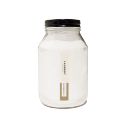 Product image of a clear glass 32oz refill mason jar that is filled with white laundry powder and has a black recyclable aluminum screw on lid.