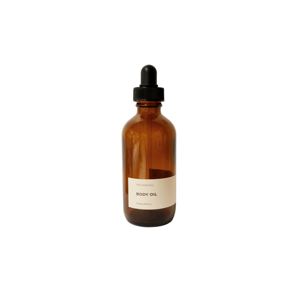 Product image of a 4oz glass amber bottle with a black dropper top for zero waste body oil refills.