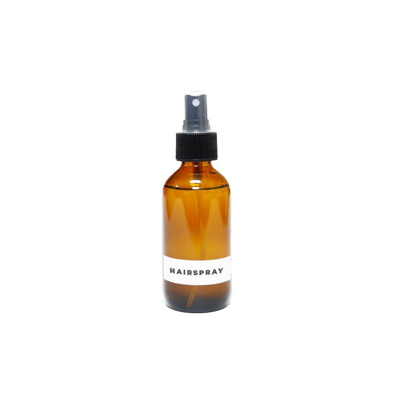 Product image of a 4oz glass amber bottle with a black spray top for zero waste hairspray refills.