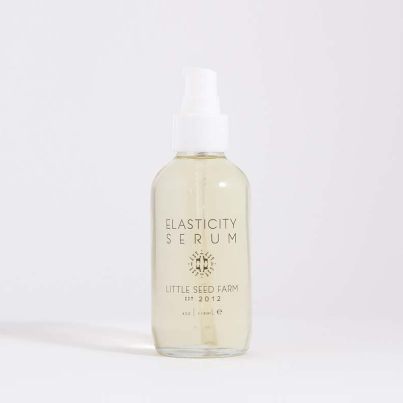 4oz. clear glass bottle of elasticity serum with a white pump top.