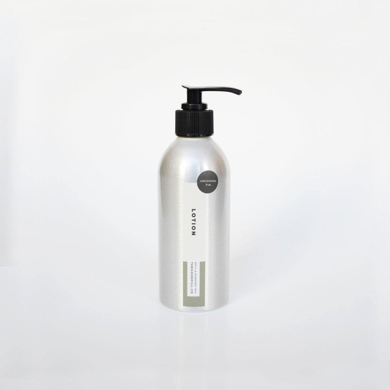 Product image of an 8oz aluminum bottle with a black pump top for zero waste face and body lotion refills.